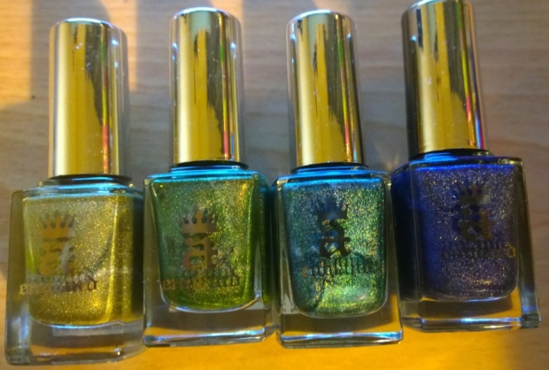 "The polishes used - all A England. Left to right ""Princess Sabra"", ""Dragon"", ""Saint George"" and ""Tristam"". Look at the beautiful shine and glimmer on them! It lost some of this through the sponging technique but retained enough to still be beautiful"