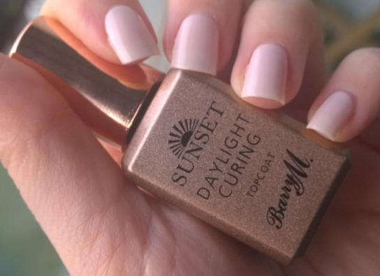 "Wearing ""Like a Nude"" on my nails and showing off the Top Coat bottle"
