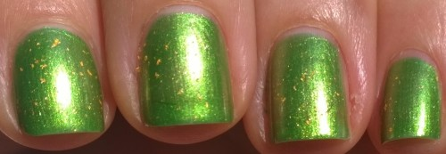 Here's a picture of the manicure in natural light. You can see the green takes on a darker hue here