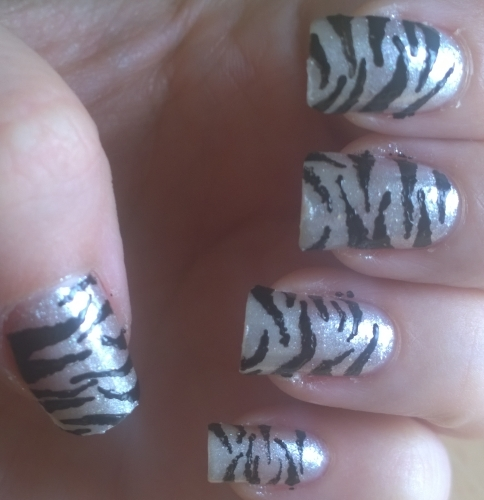 Day 13: Animal Print. My very first nail art 19 years ago was a tiger print so I had to do this one well, it's the design I've done the most over my years of nail art. I suppose it's meant to be a zebra print but actually makes me think of Tristam, Adina of A England's adorable silver tabby cat.