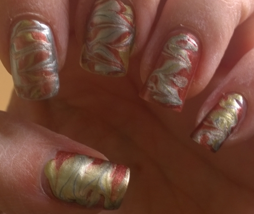 Day 20: Watermarble. This is a recreation of something already in the nail art gallery, last years autumn metallic nails but I did it straight on the nail instead of actually watermarbling. Not bad, needs a little refinement of technique though