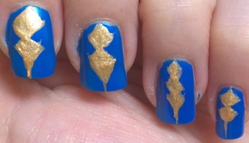 Day 5: Blue. Inspired by a sword in Final Fantasy: Realm Reborn (Aymeric's, for those who play). The pattern on it was far too complex to fit on a nail but I took a section of it and kind of made it work. Should have used striping tape for crisper lines though.