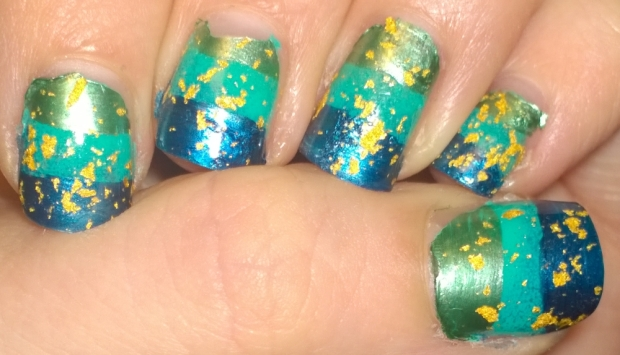 Nail fail alert! I was trying to get some sort of aquatic feel to these I think but the stripes are just appalling and the attempt to cover it up with gold flakes just made it worse...
