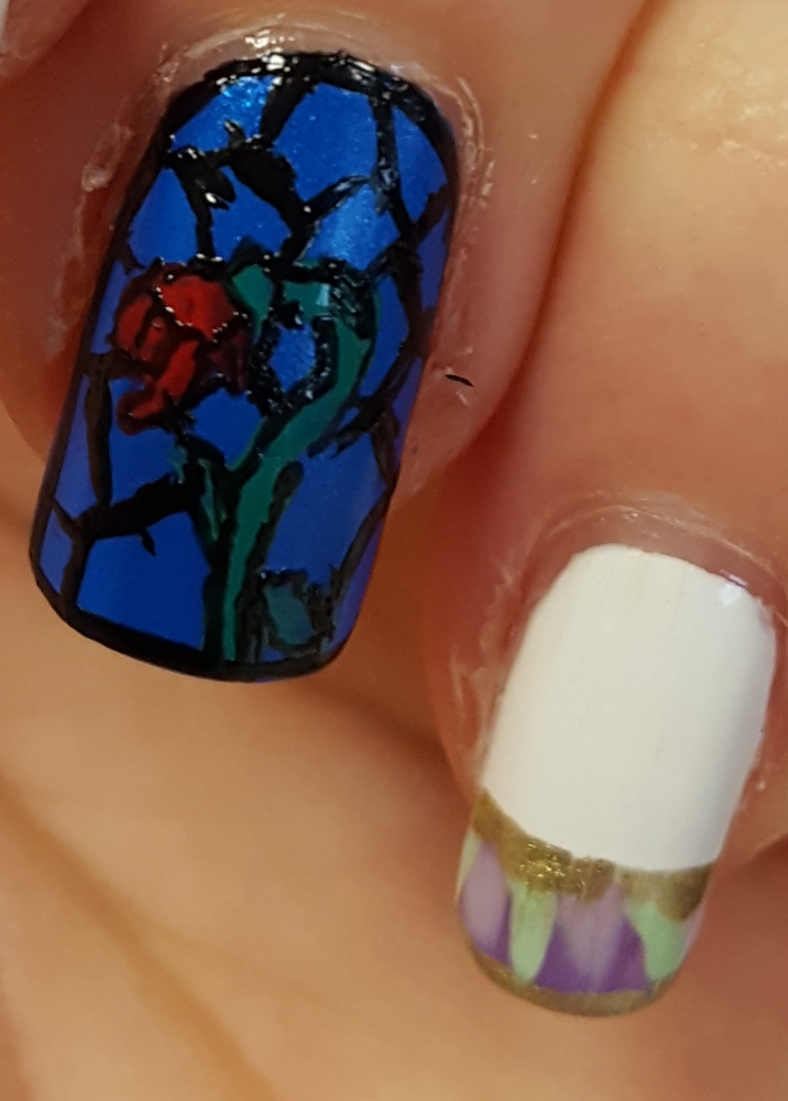 Finally I used a Models Own nail art pen to draw the black outlines on for the stained glass window. This helped make the rose look a bit more rose like